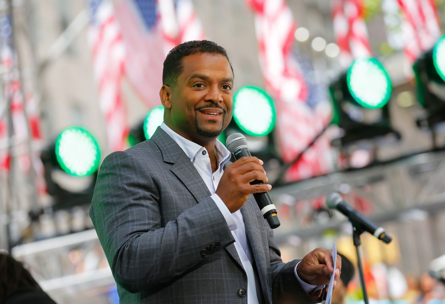 Alfonso Ribeiro as the emcee of Side by Side