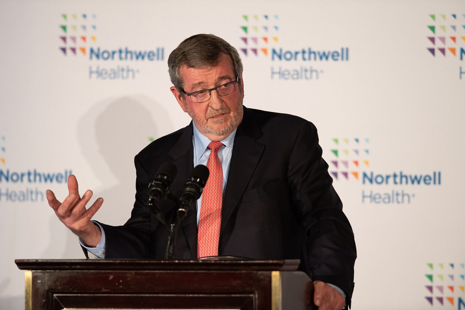 Michael Dowling speaking at a podium