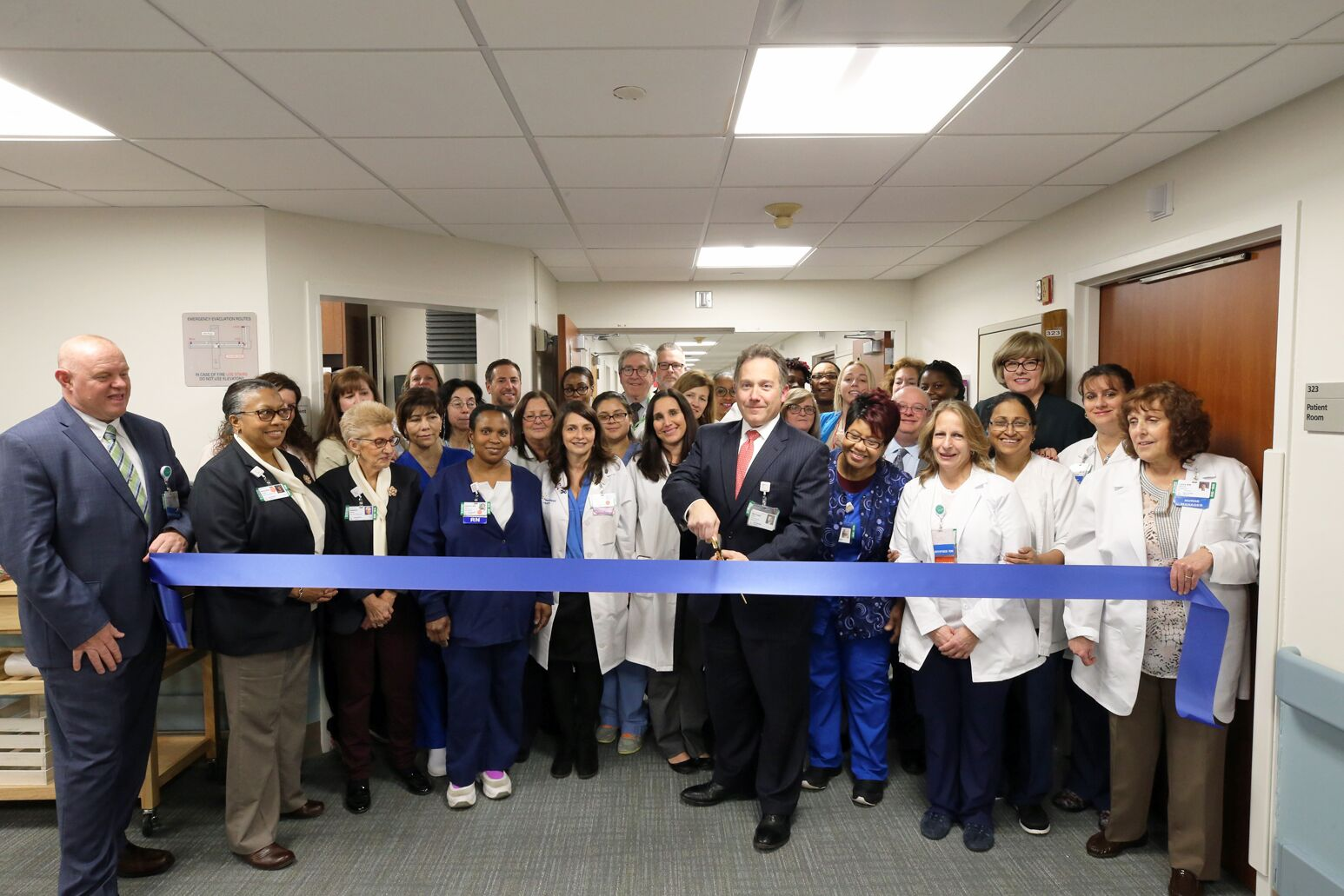 Plainview Hospital executive director Michael Fener cuts the ribbon in newly renovated telemetry unit