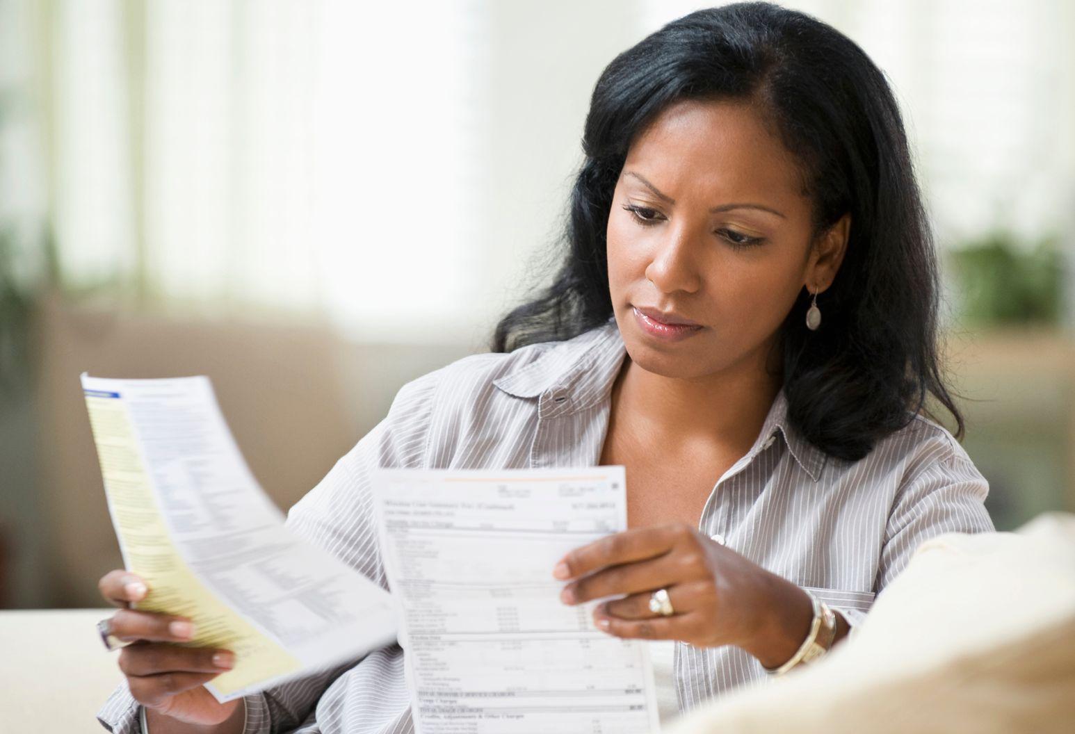 A woman checks her bills