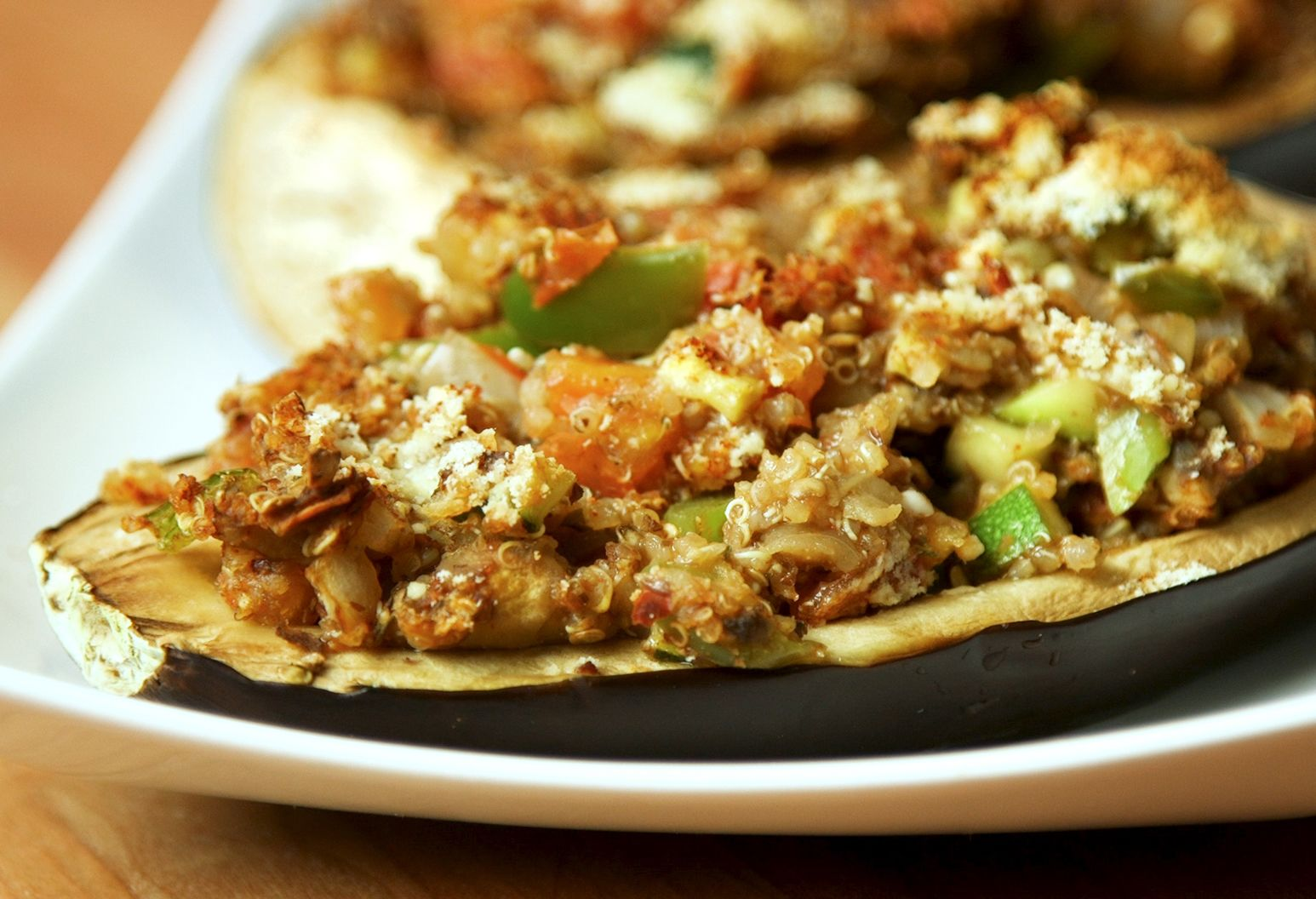 A close-up of quinoa and veggie-stuffed eggplant