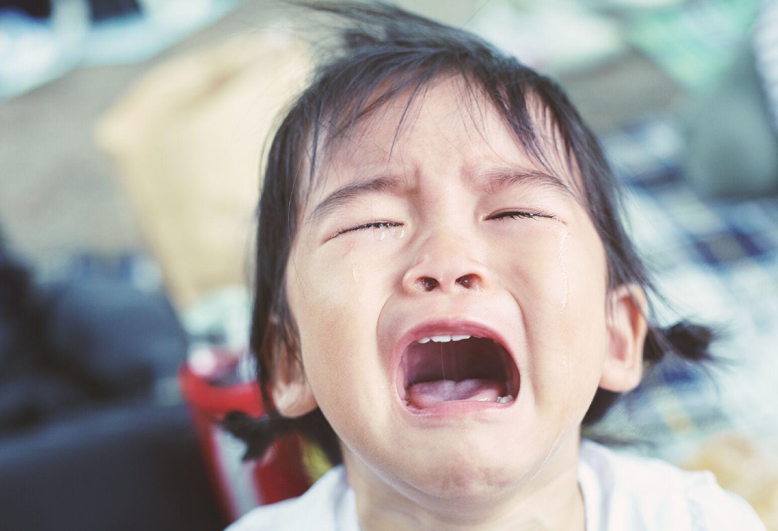 Child crying at the camera