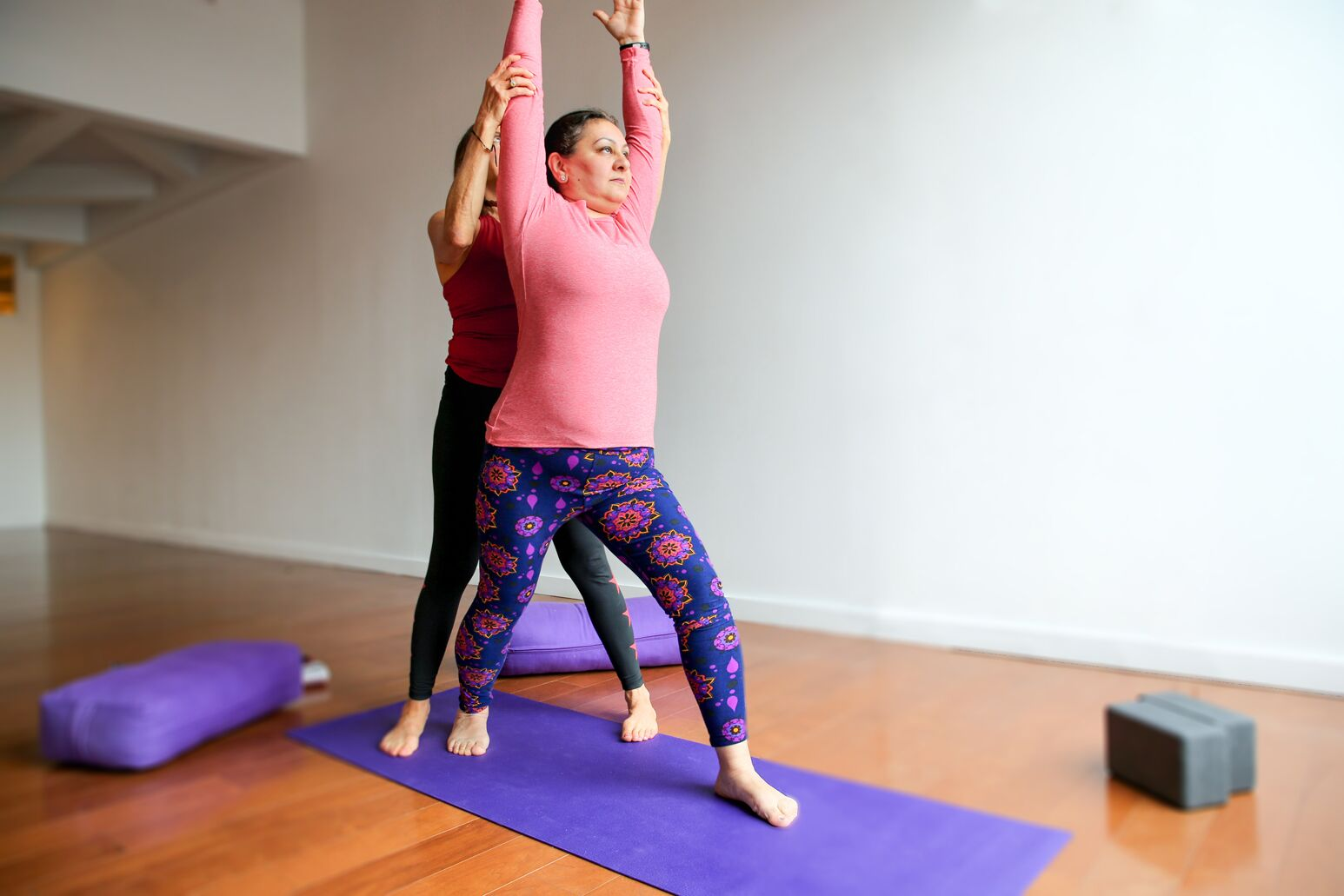Kathy Khodadadi does yoga, part of her newfound healthy lifestyle after being diagnosed with nonobstructive coronary artery disease.