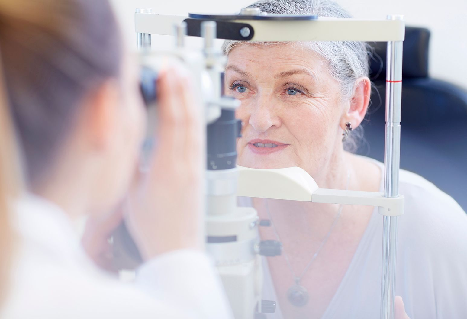 Older woman receiving eye test from physician