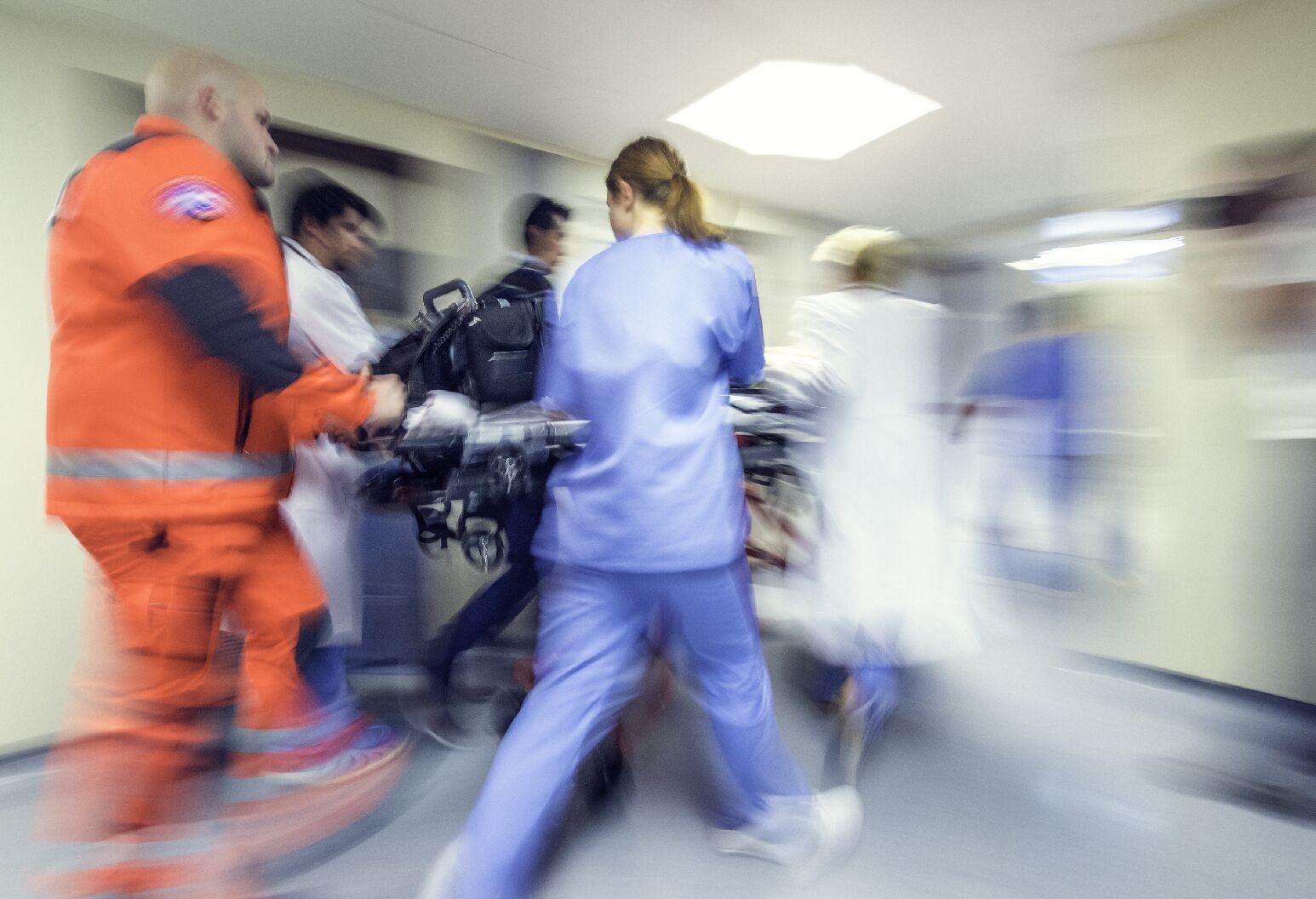 Emergency room staff rushes patient in from ambulance