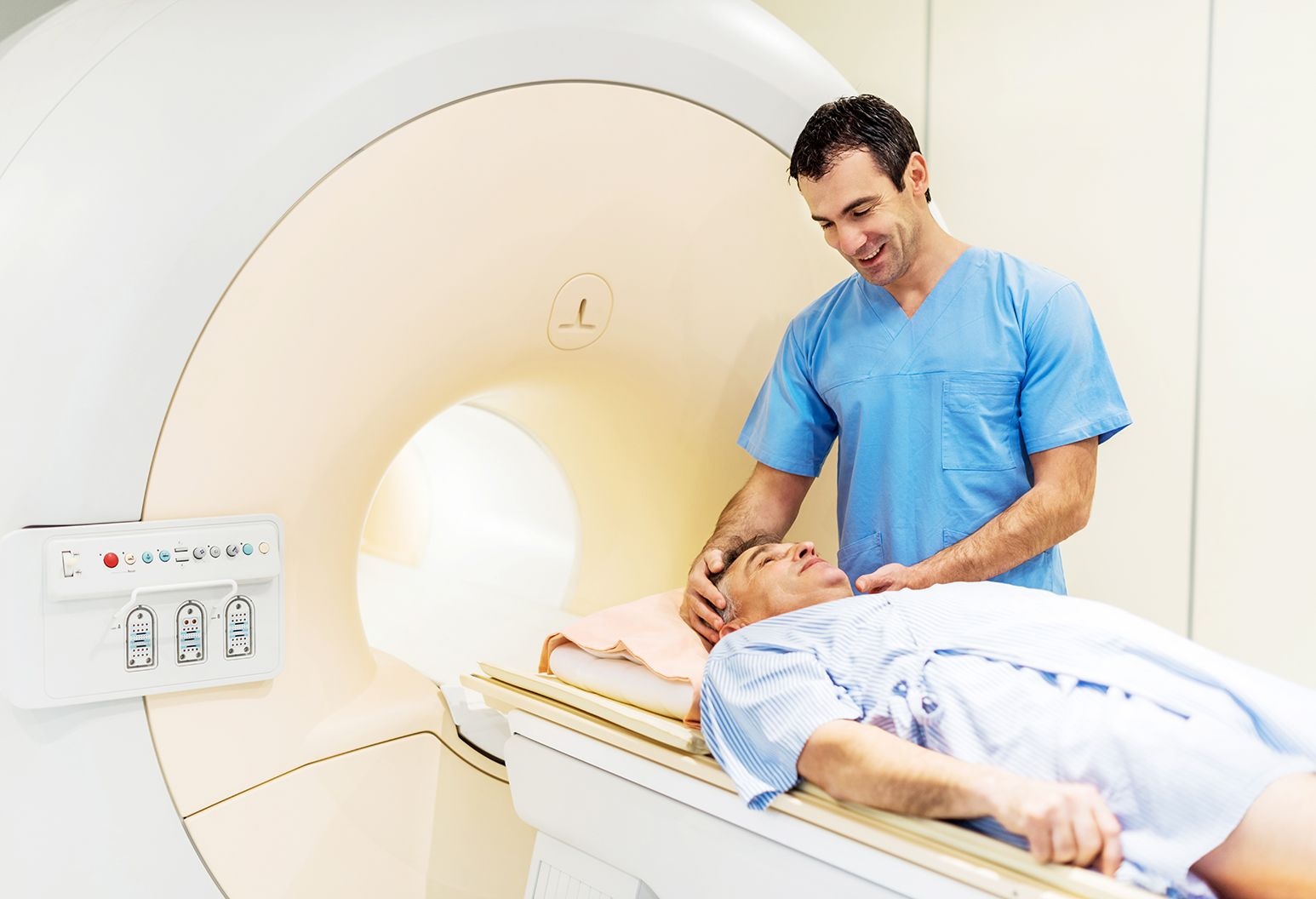 radiologist is preparing a patient who is about to take an MRI Scan.