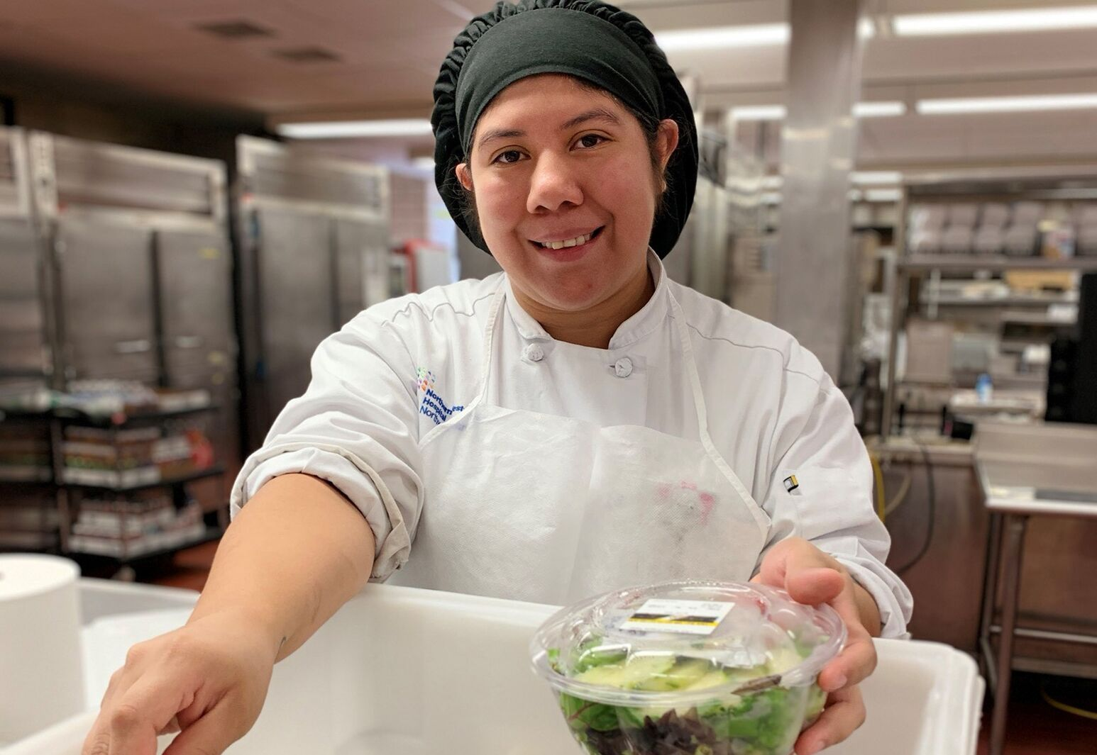 Vickiana Alejandro, of Northern Westchester Hospital's food services, packs up sandwiches and salads for the Food Recovery Program.