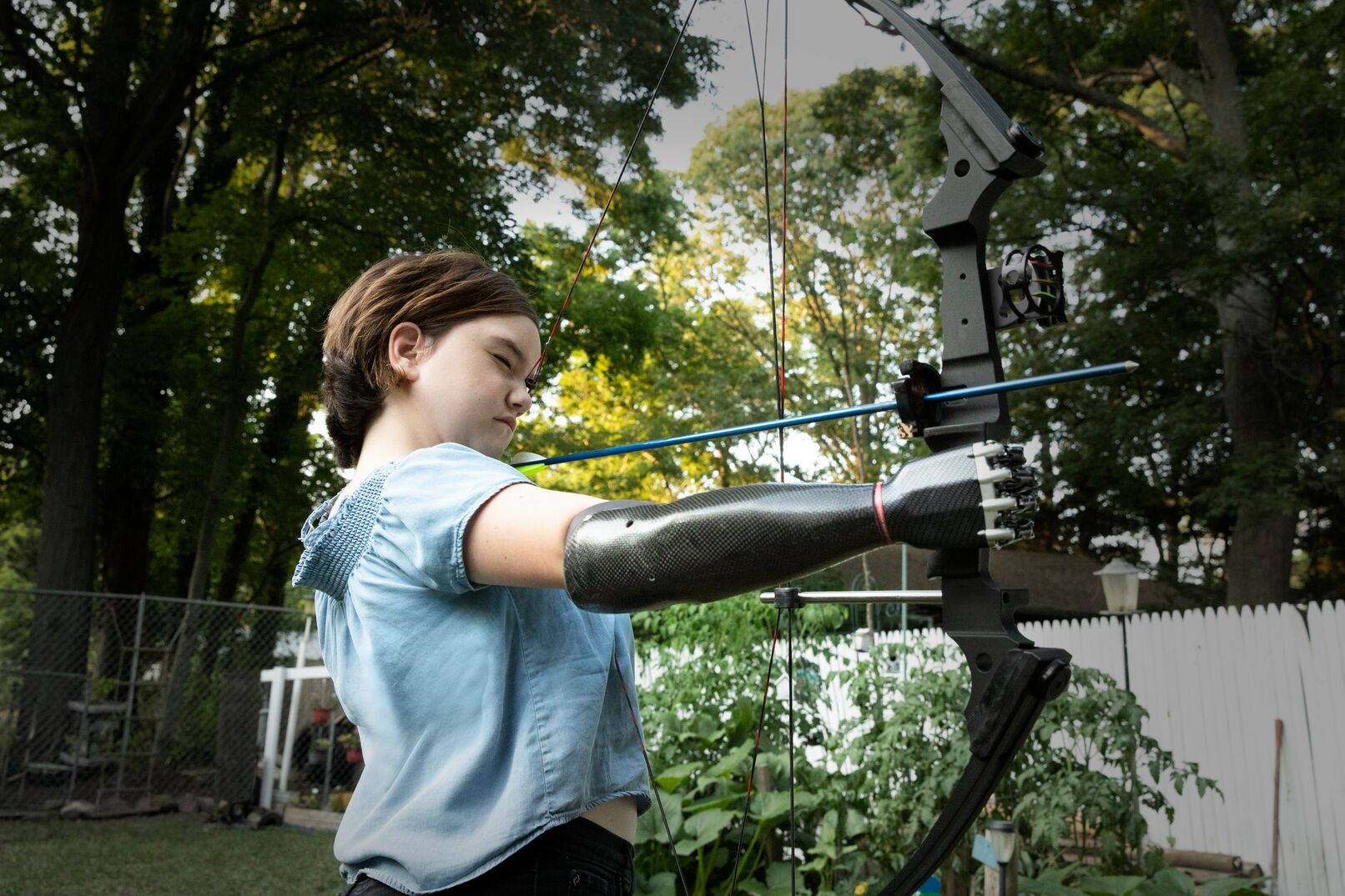 13-year-old girl with a bionic arm shoots a bow and arrow