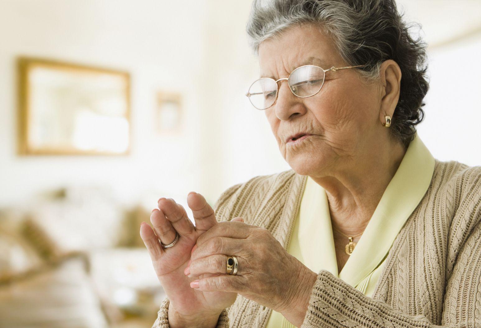 Elderly women inspecting her hands