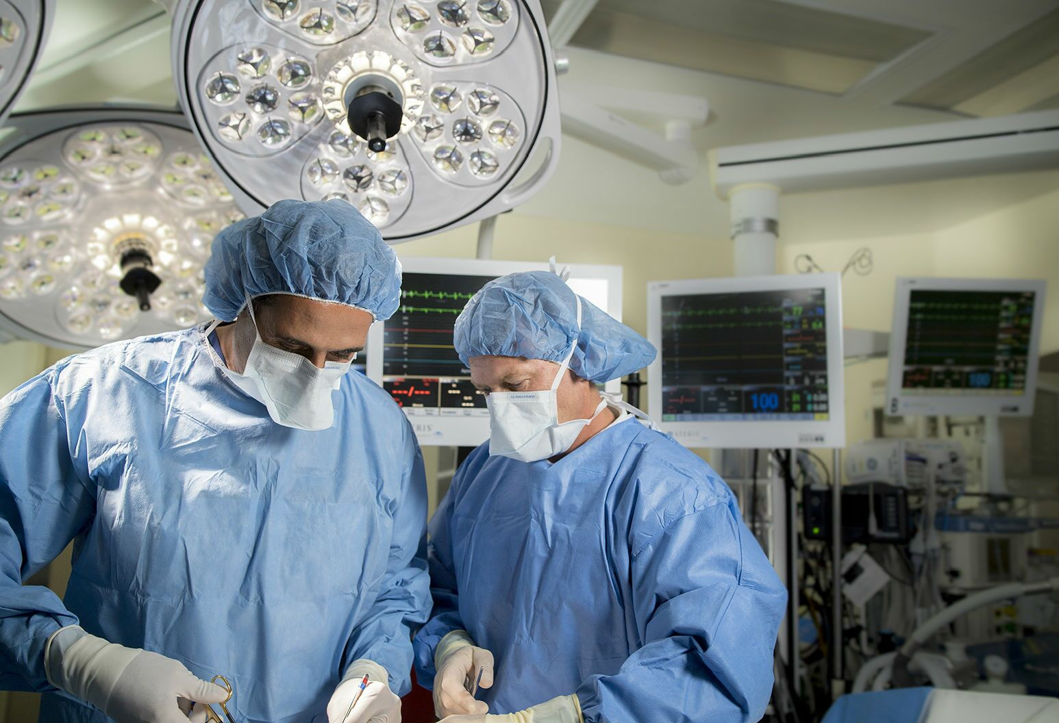 Left: One of New York State's top ranked cardiothoracic surgeons, Southside Hospital's Robert Kalimi, MD, performing surgery.