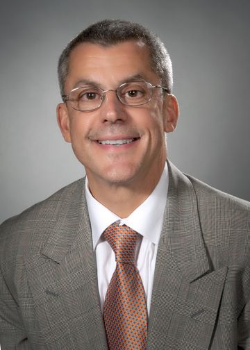 Joseph Marino, MD, medical director at LIJ Valley Stream, wearing an orange tie.