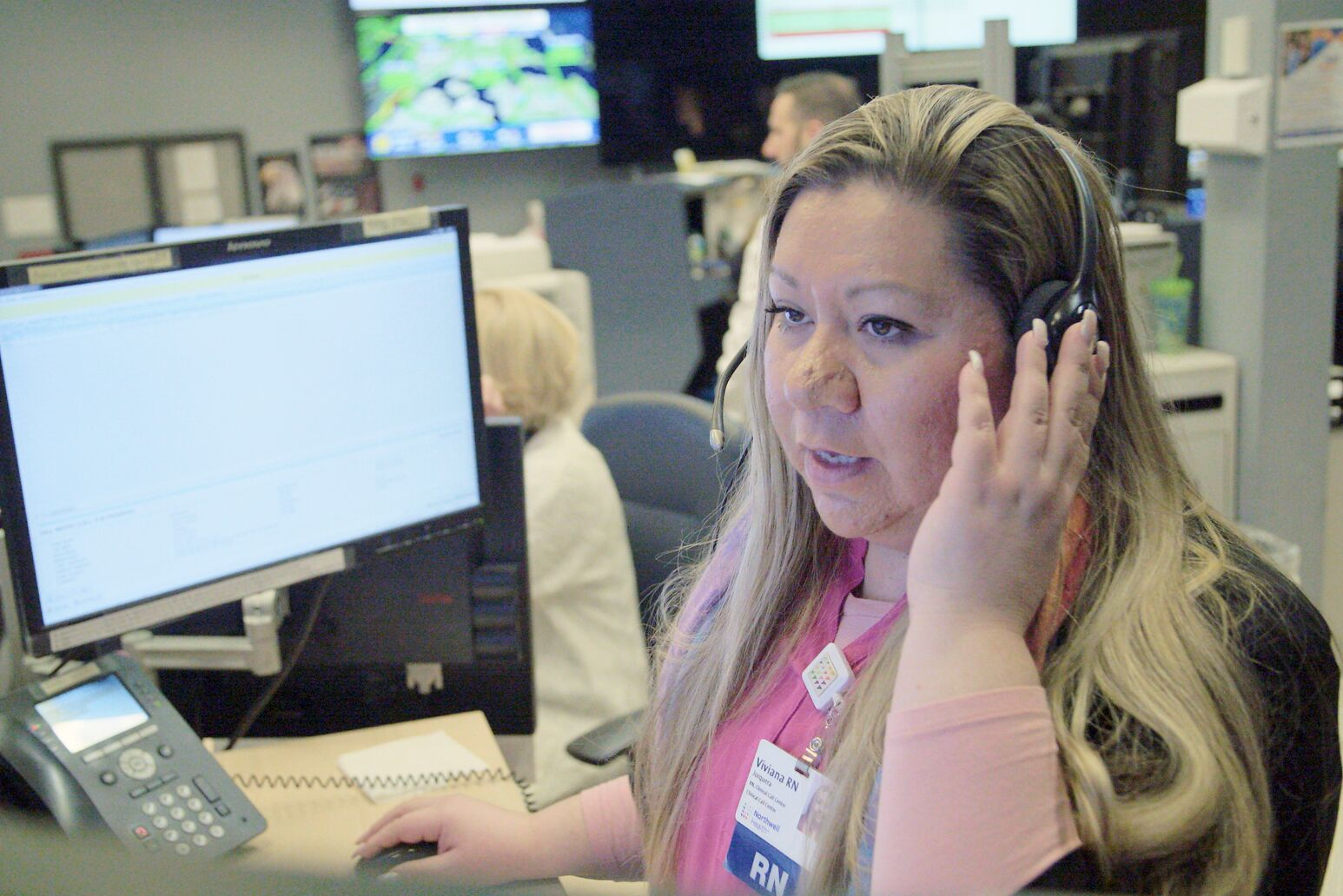 A registered nurse provides advice at Northwell Health's employee Clinical Call Center.