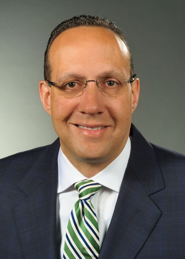 Barry Kaplan, MD, wearing a green and blue tie