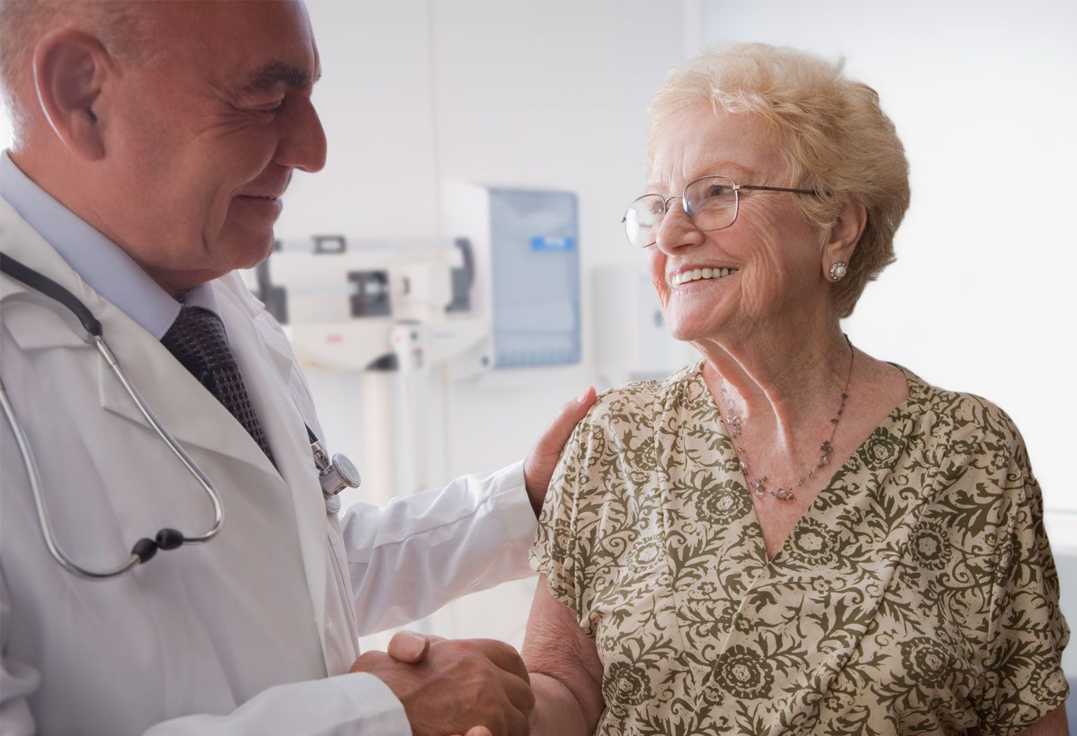 Doctor shakes hand of senior female patient