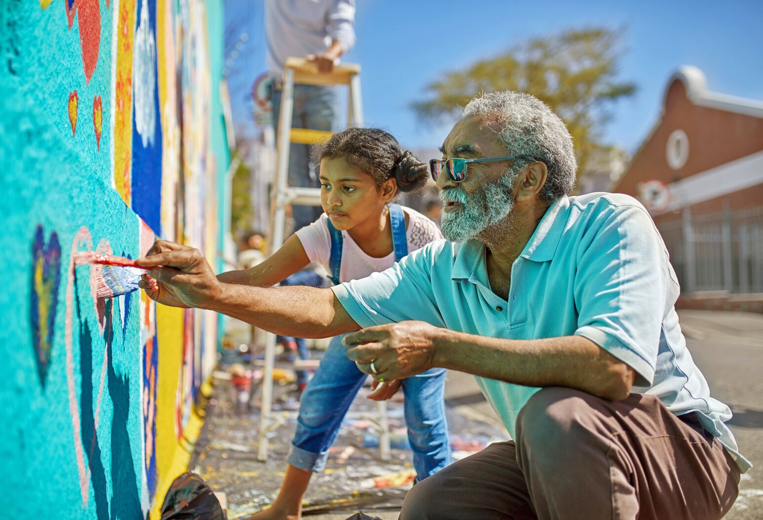 A black man and his granddaughter paint a mural. Michael Dowling explains how removing bad behaviors like vaping, smoking and drinking, can help you achieve optimal health.