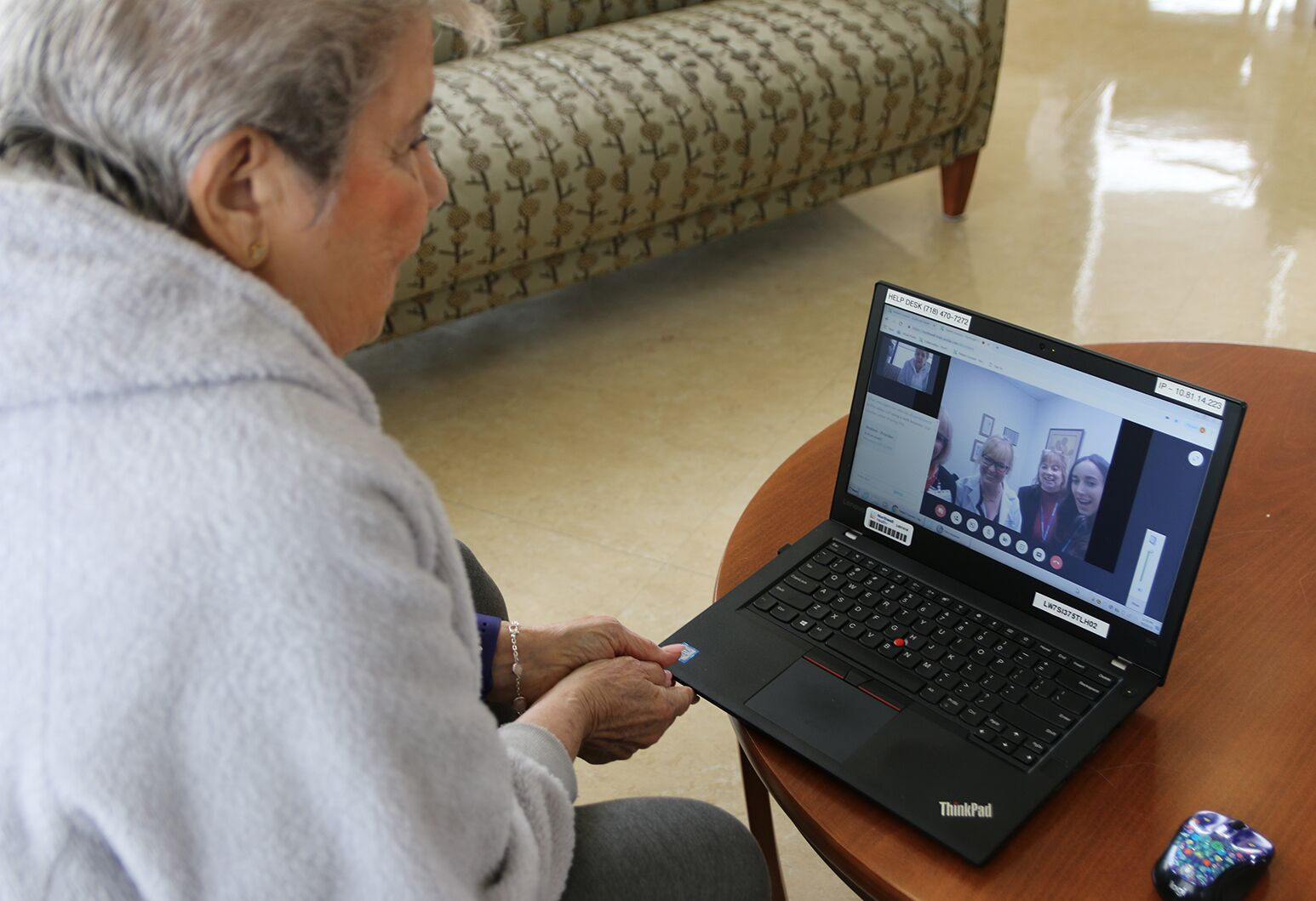 A patient in Staten Island University Hospital's new telemedicine program talks remotely with her health team.