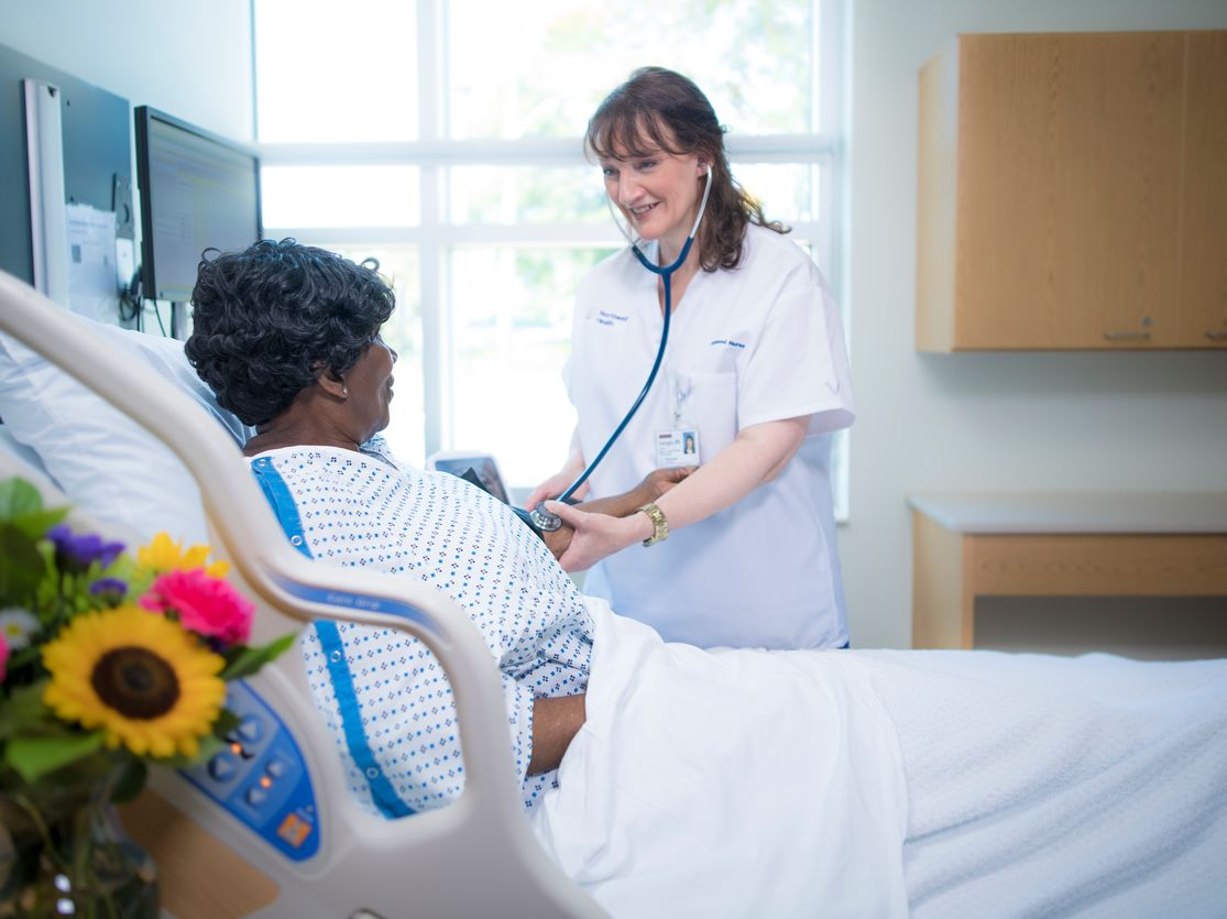 A Northwell Health nurse checks the blood pressure of a patient.