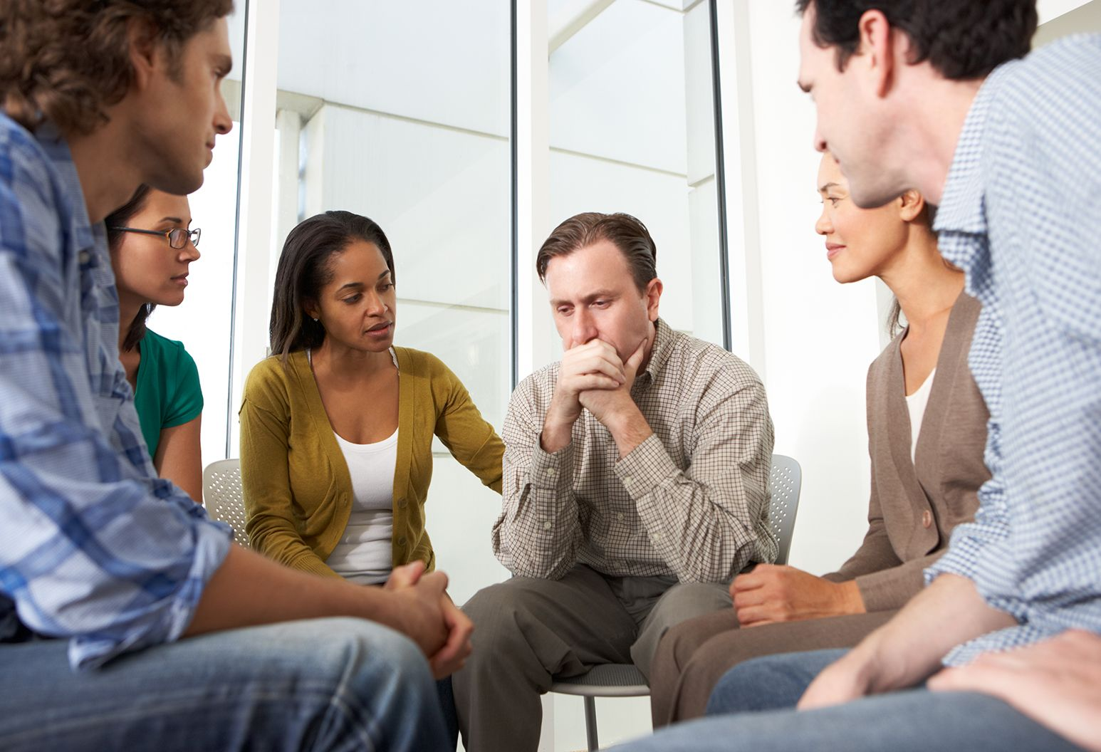 Meeting Of Support Group Having A Conversation