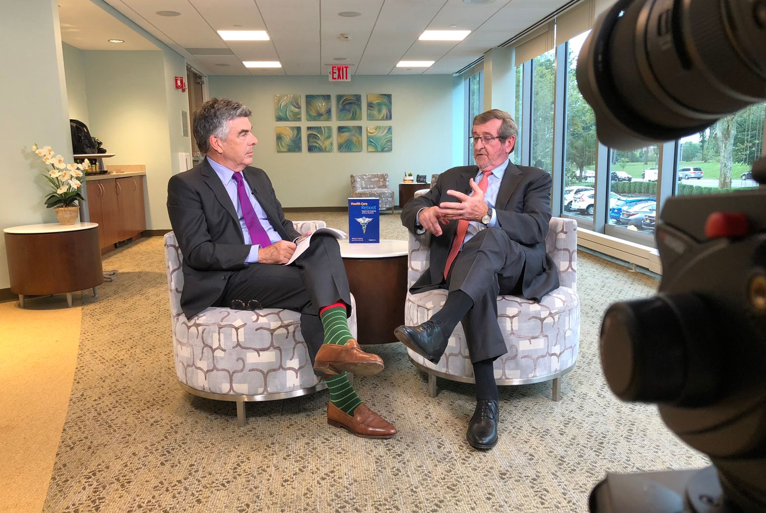 Charles Kenney (left) and Northwell Health President and CEO Michael Dowling discuss the release of their new book Health Care Reboot: Megatrends Energizing American Medicine