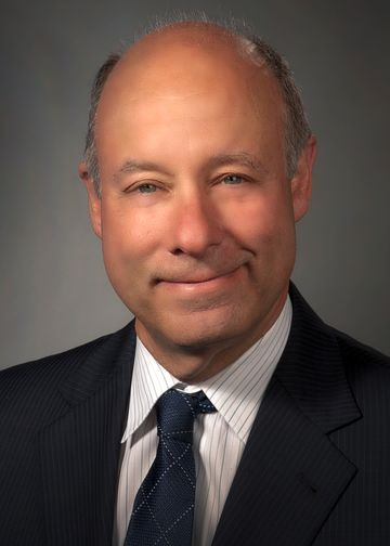 Charles Schleien, MD, wearing a dark blue tie