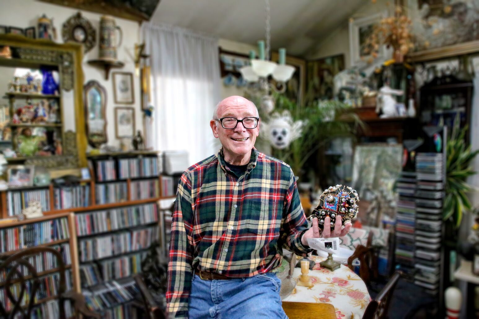 John Fischer, at home with his eclectic collection of memorabilia. The Enhanced Recovery Program helped him heal after colorectal surgery.