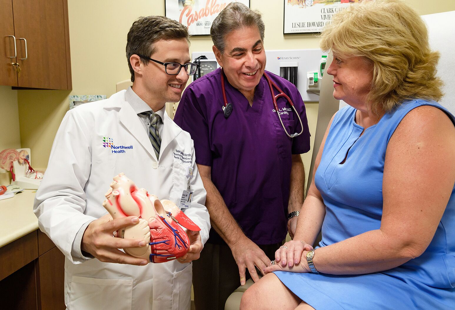 From left: Drs. Benjamin Hirsh and Guy Mintz, co-directors of Sandra Atlas Bass Heart Hospital Lipid Center, meet with a patient.