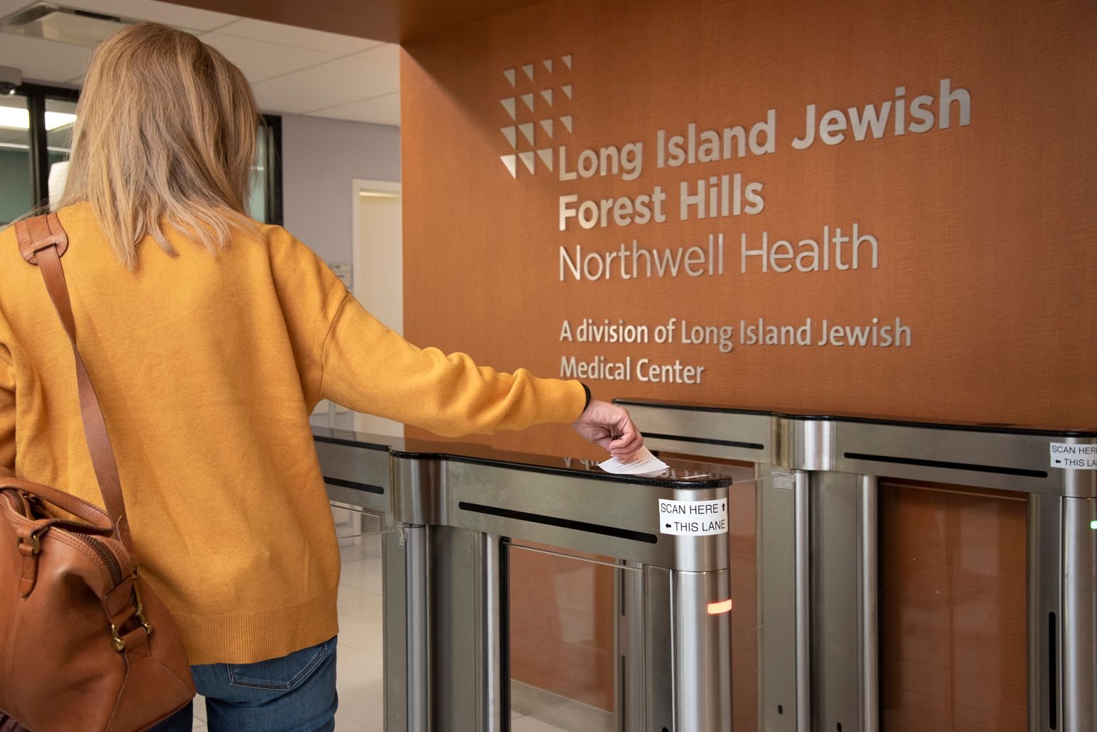 Visitors at LIJ Forest Hills need to scan a temporary computer-generated visitor badge with their photo and a barcode in order to pass through the hospital turnstiles.