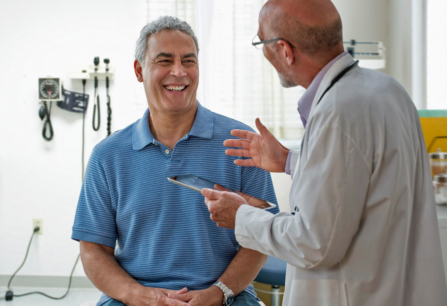 A doctor talks to an older man about active surveillance for his prostate cancer, which can be beneficial if you have low-risk disease.