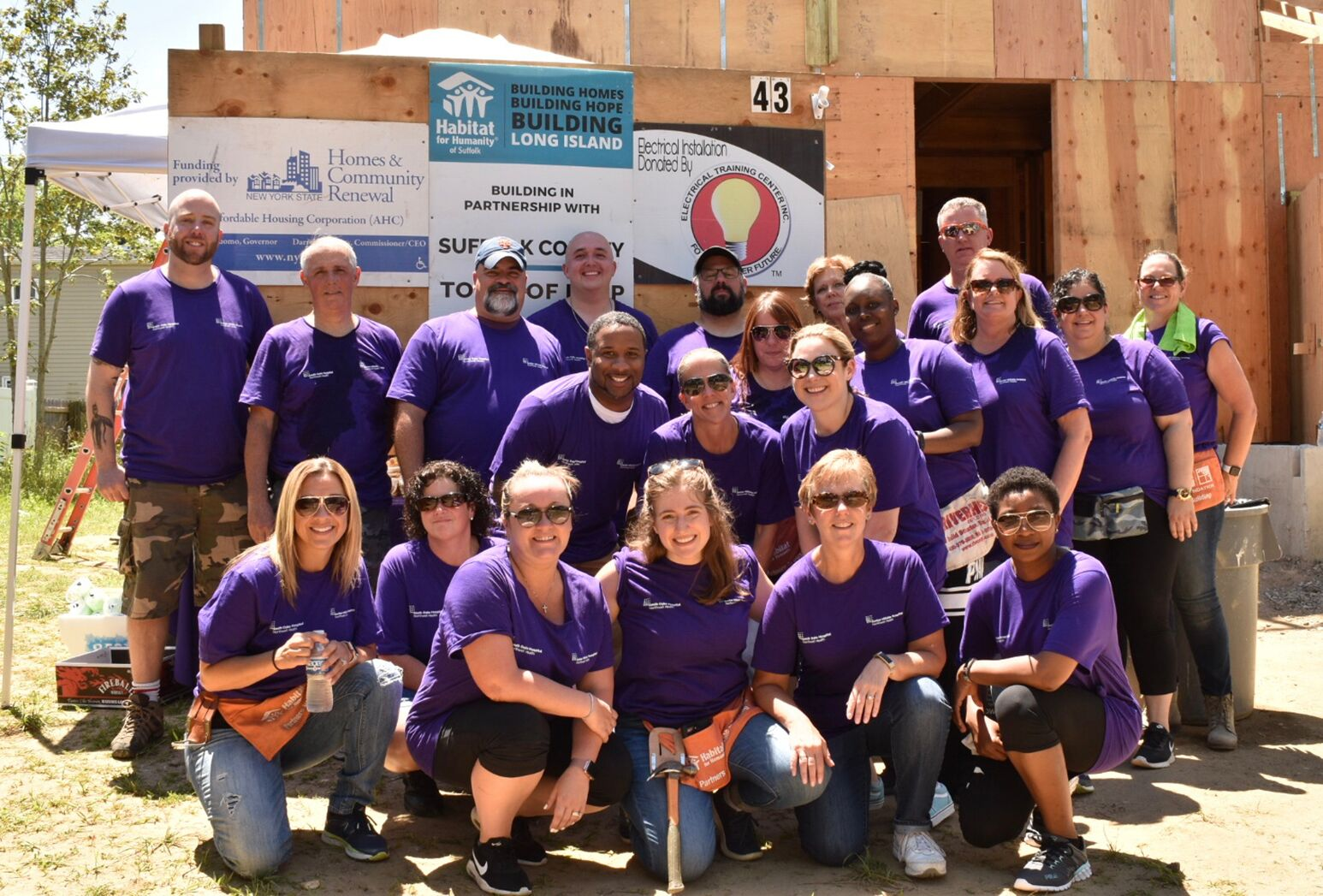 South Oaks Hospital employees participate in a Habitat for Humanity build in Central Islip.