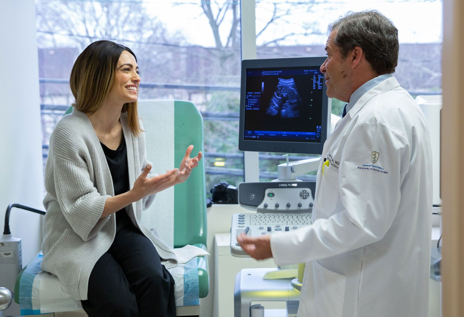 Physician and patient looking at a sonogram
