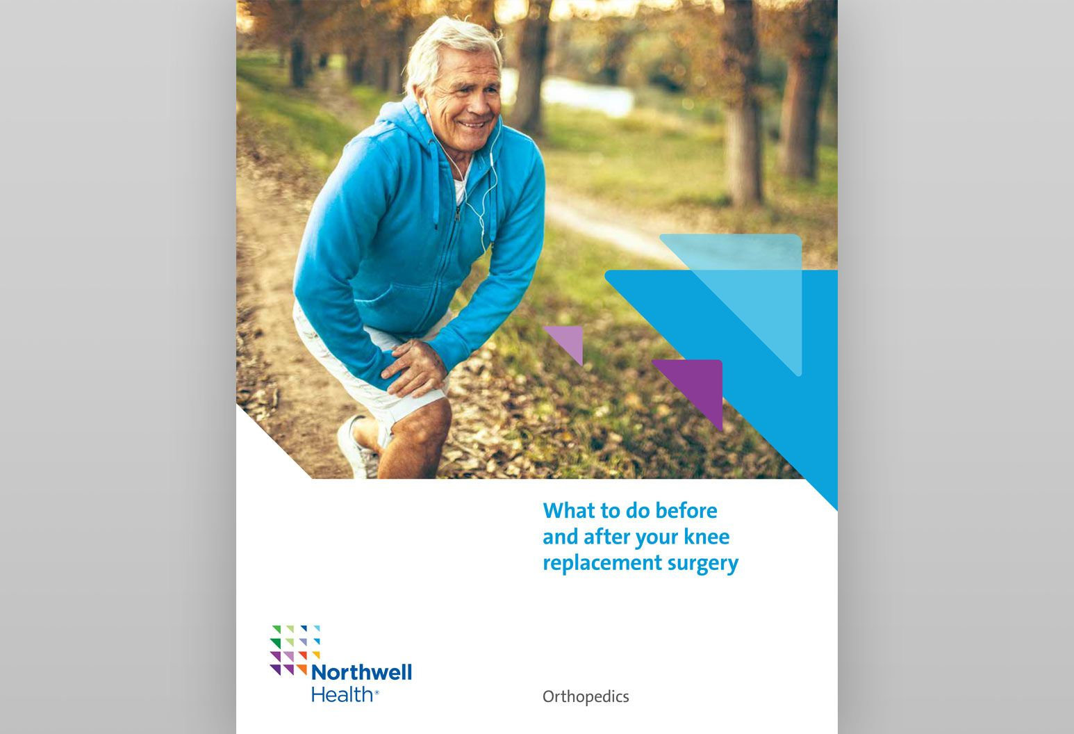 On the cover of a booklet about what to do before and after your knee replacement surgery, there is an elderly man kneeling and stretching. He's wearing a blue sweatshirt and has earbuds in.
