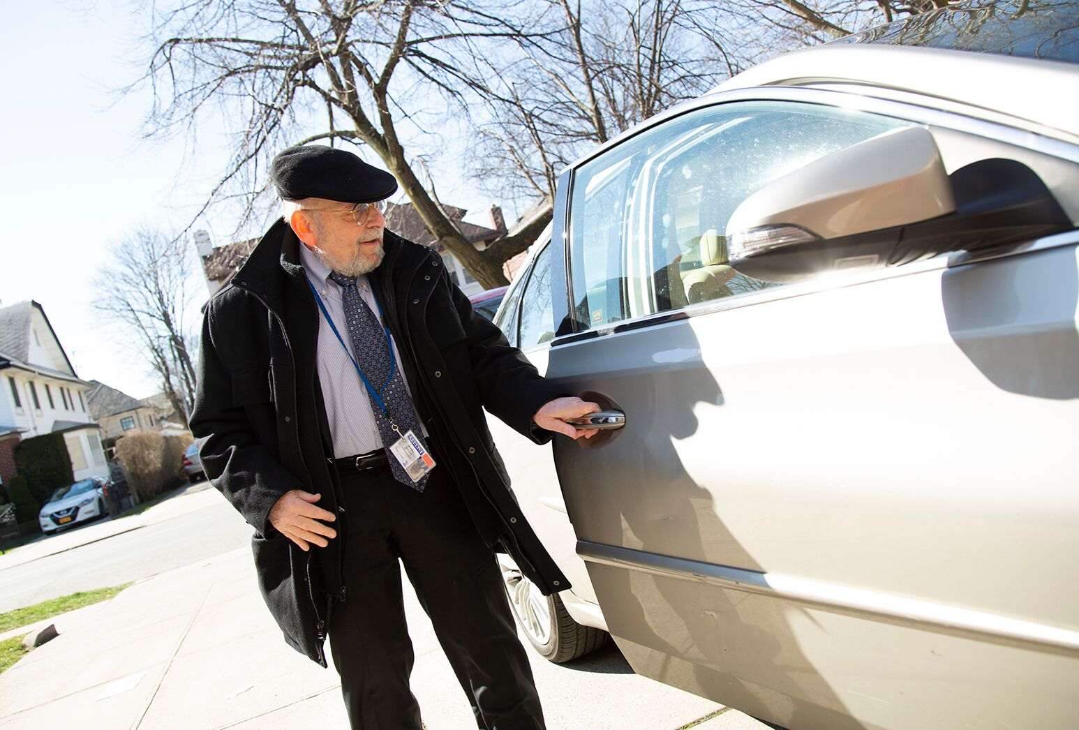 Man in his 70s who had double knee replacement surgery opening a car door