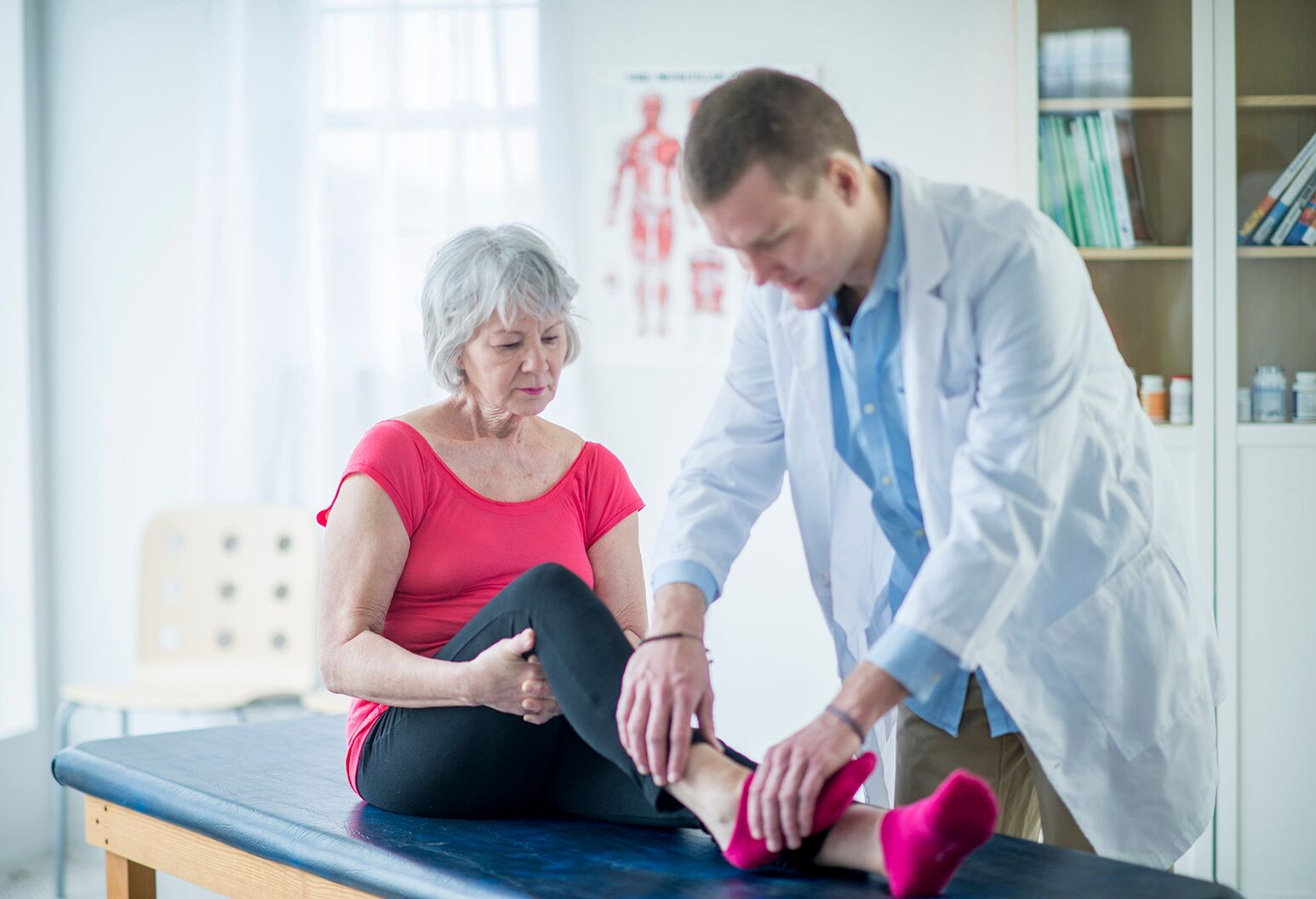 Physician examining patients ankle