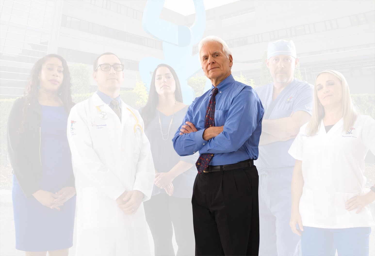 An experienced doctor separates from the rest of the team and the background. His arms are crossed heroically.