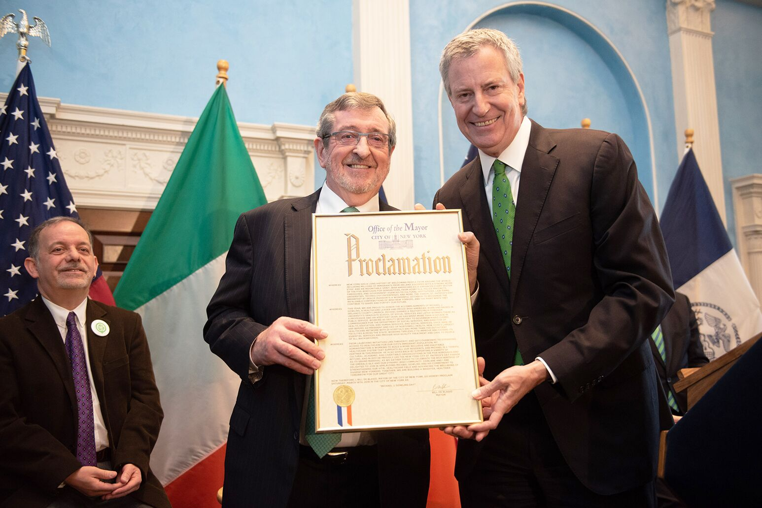 "From left: Michael Dowling and Mayor Bill de Blasio with a proclamation declaring March 16 as ""Michael Dowling Day"" across New York City."