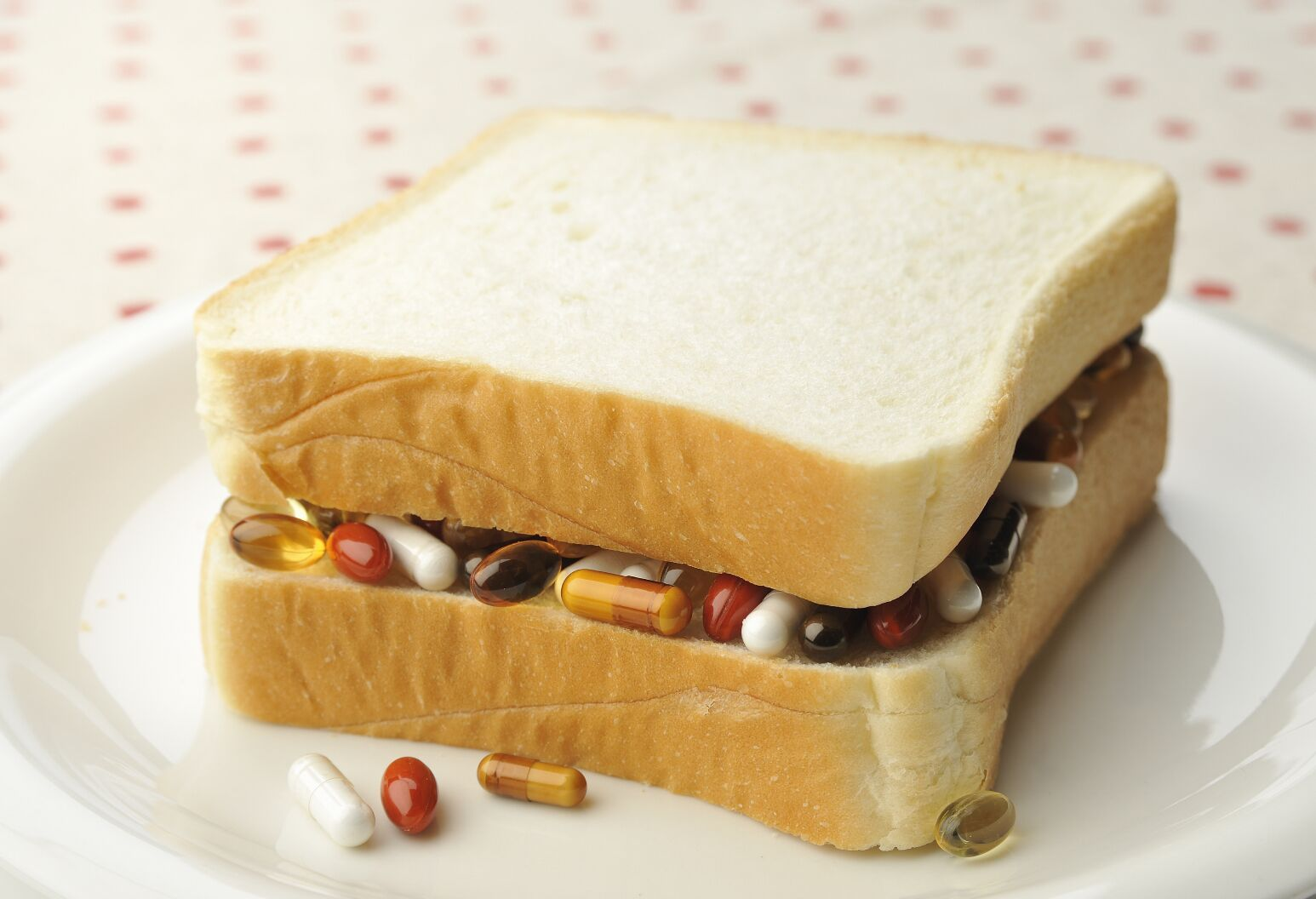 Supplements sandwiched between two slices of white bread.