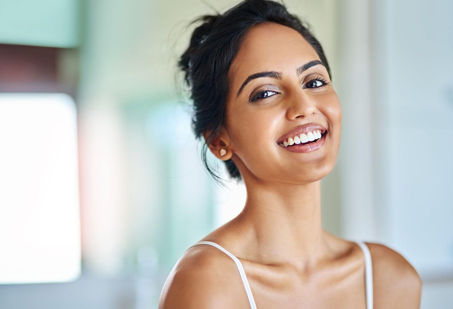 Beautiful woman looking at the camera smiling