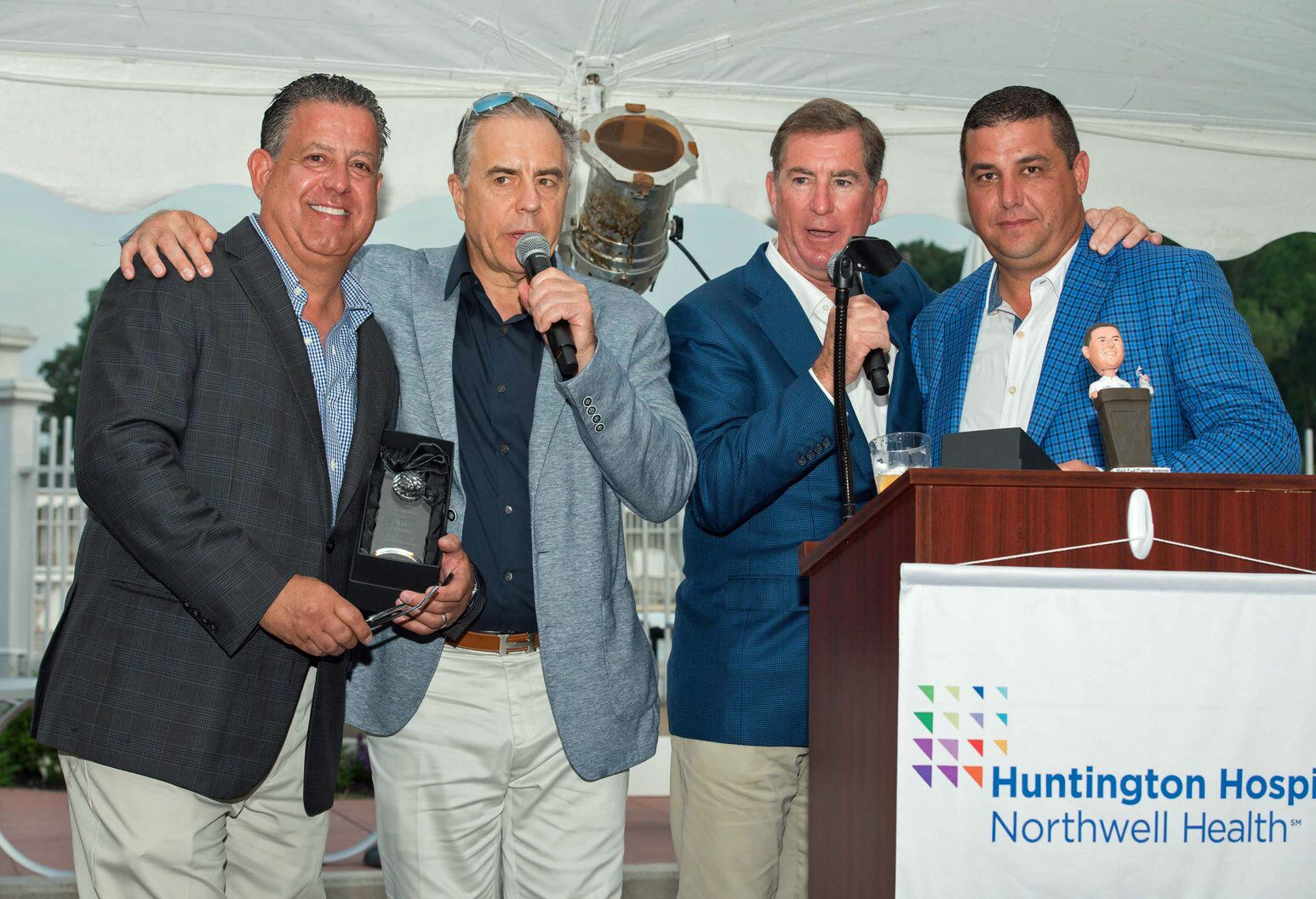 At Huntington Hospital's Golf Classic. From left — co-honoree Sal Ferro, Alure Home Improvements; committee member Douglas Partrick; committee chair John Kean and co-honoree Kris Amplo, JC Steel