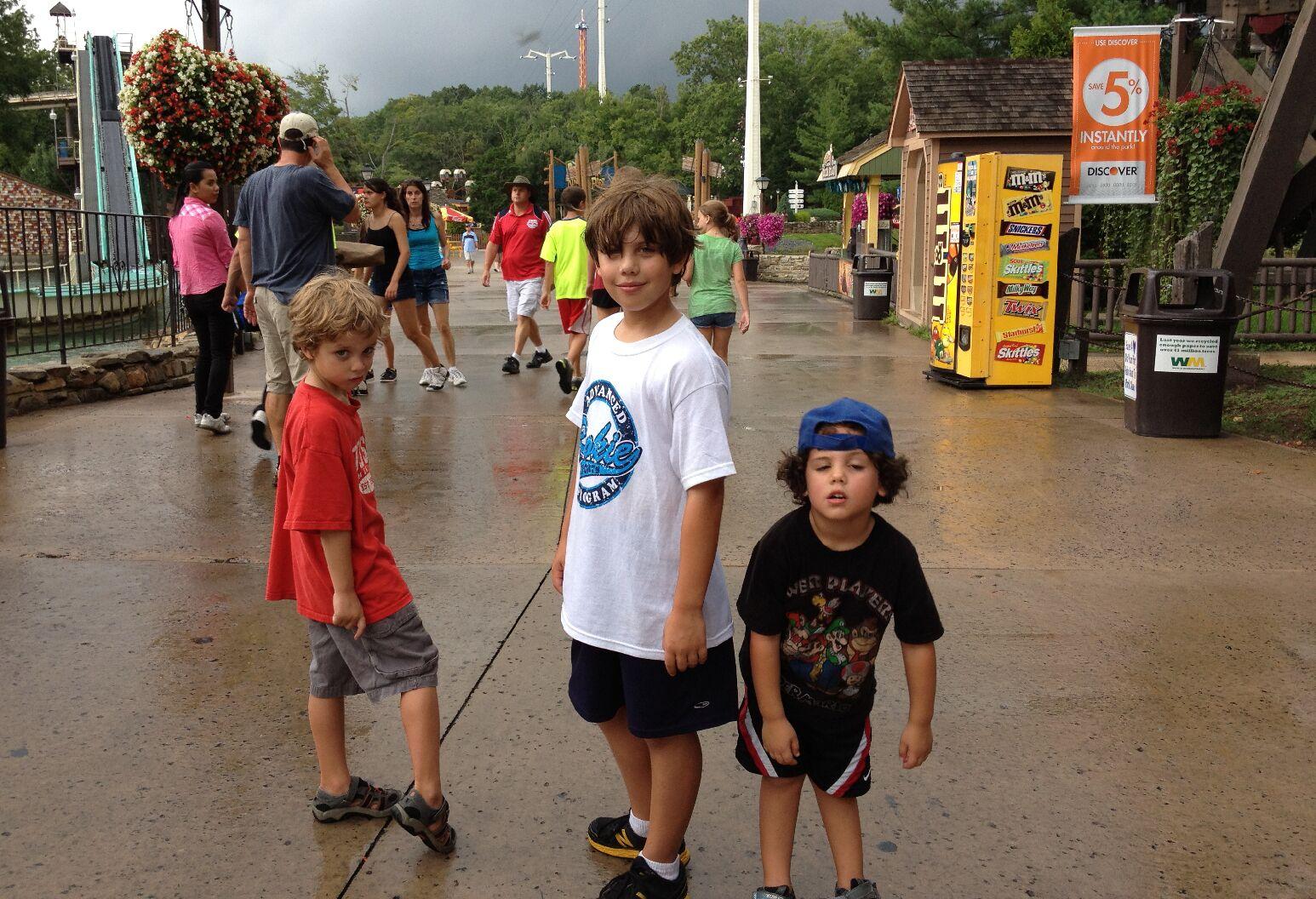 3 boys standing in park
