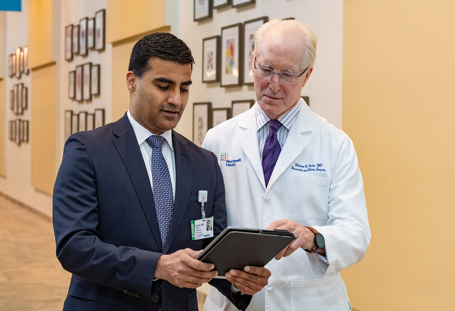 Two doctors having a conversation looking at a tablet