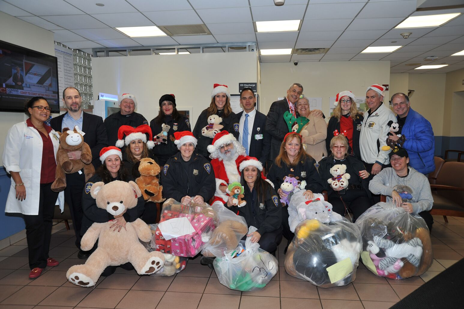 Long Island Jewish Valley Stream Hospital medical staff receive teddy bear donations for pediatric patients from the New York State Fraternal Order of Court Officers.