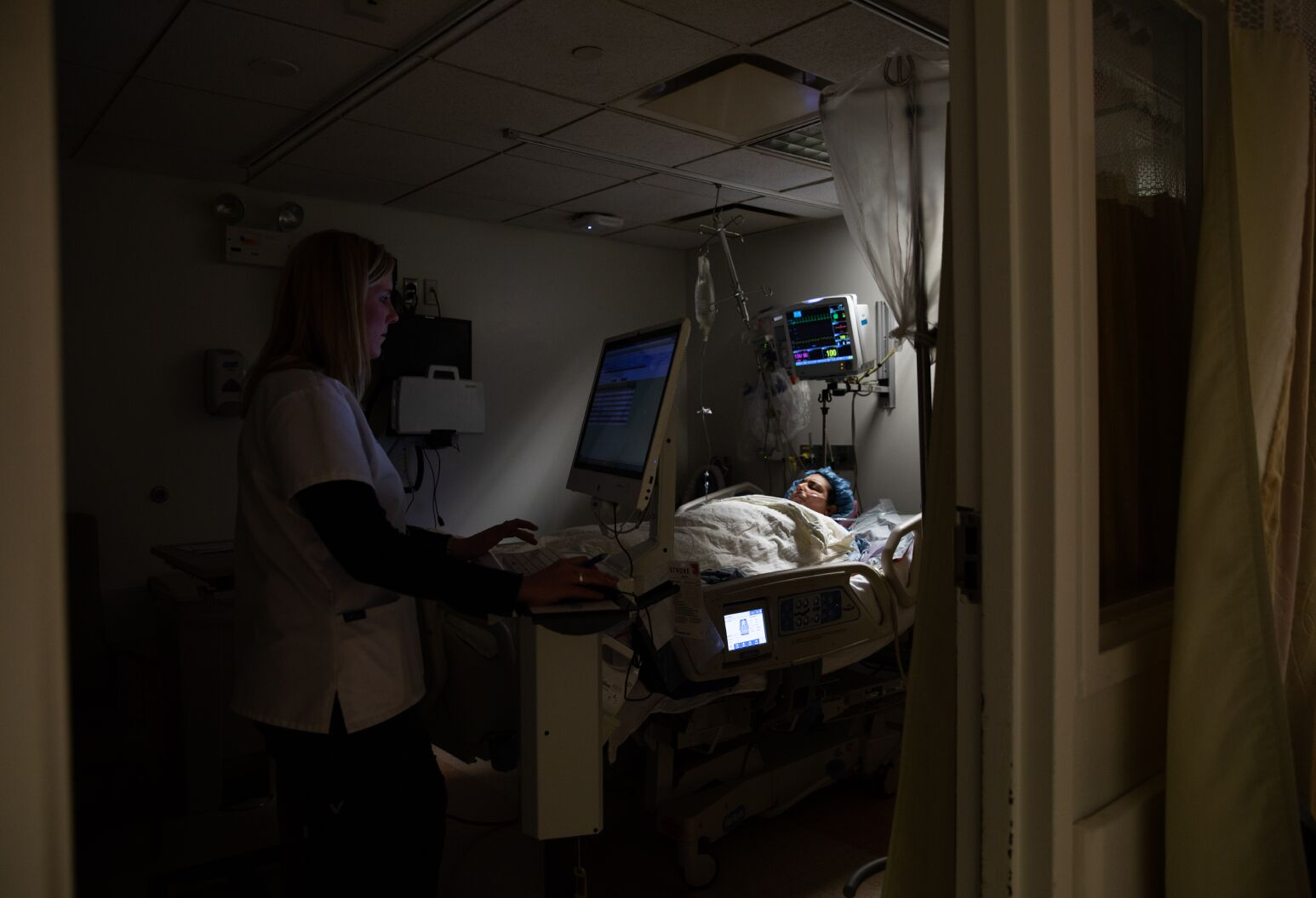 A nurse checks in on Kimberly after the surgery, during which 80% of her stomach was removed