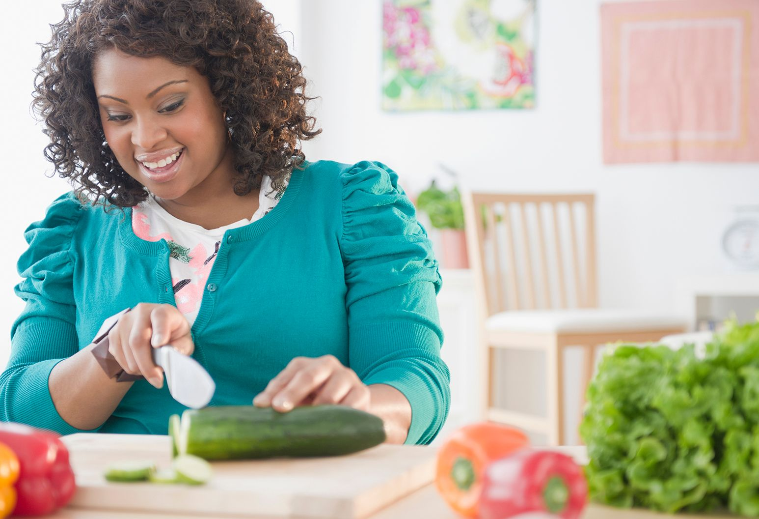 African American woman slicing vegetables
