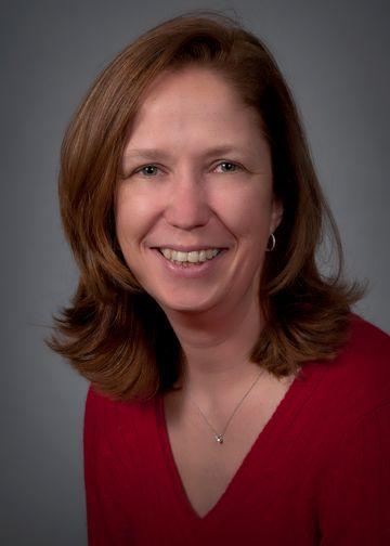Andrea Vambutas, MD, wearing a red shirt