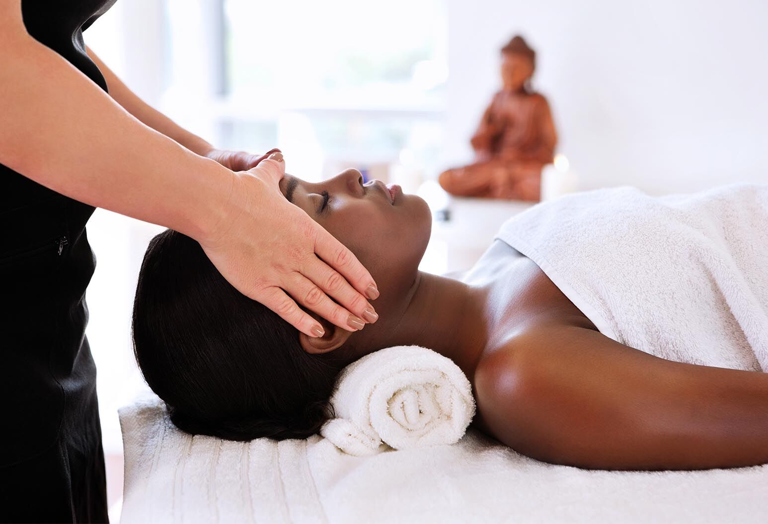 Beautiful young woman receives a energy healing treatment.