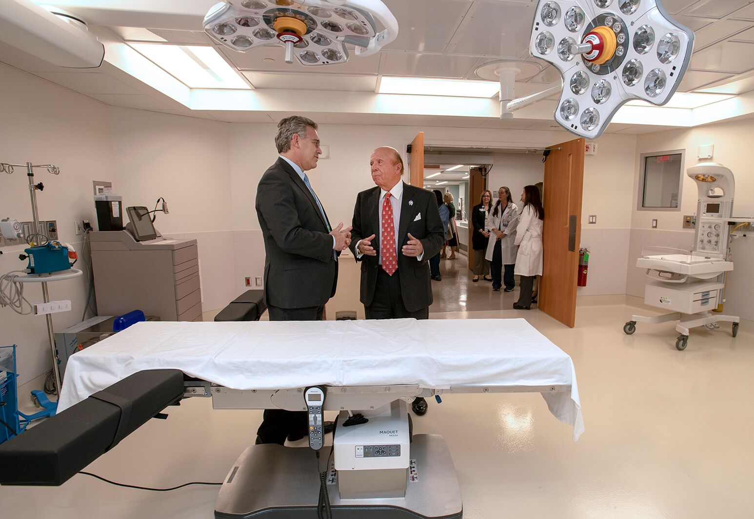 Northwell Health donor Saul Katz, right, tours Katz Women's Hospital's new operating room at North Shore University Hospital with Dr. Michael Nimaroff, the health system's senior vice president and executive director of obstetrics and gynecology.