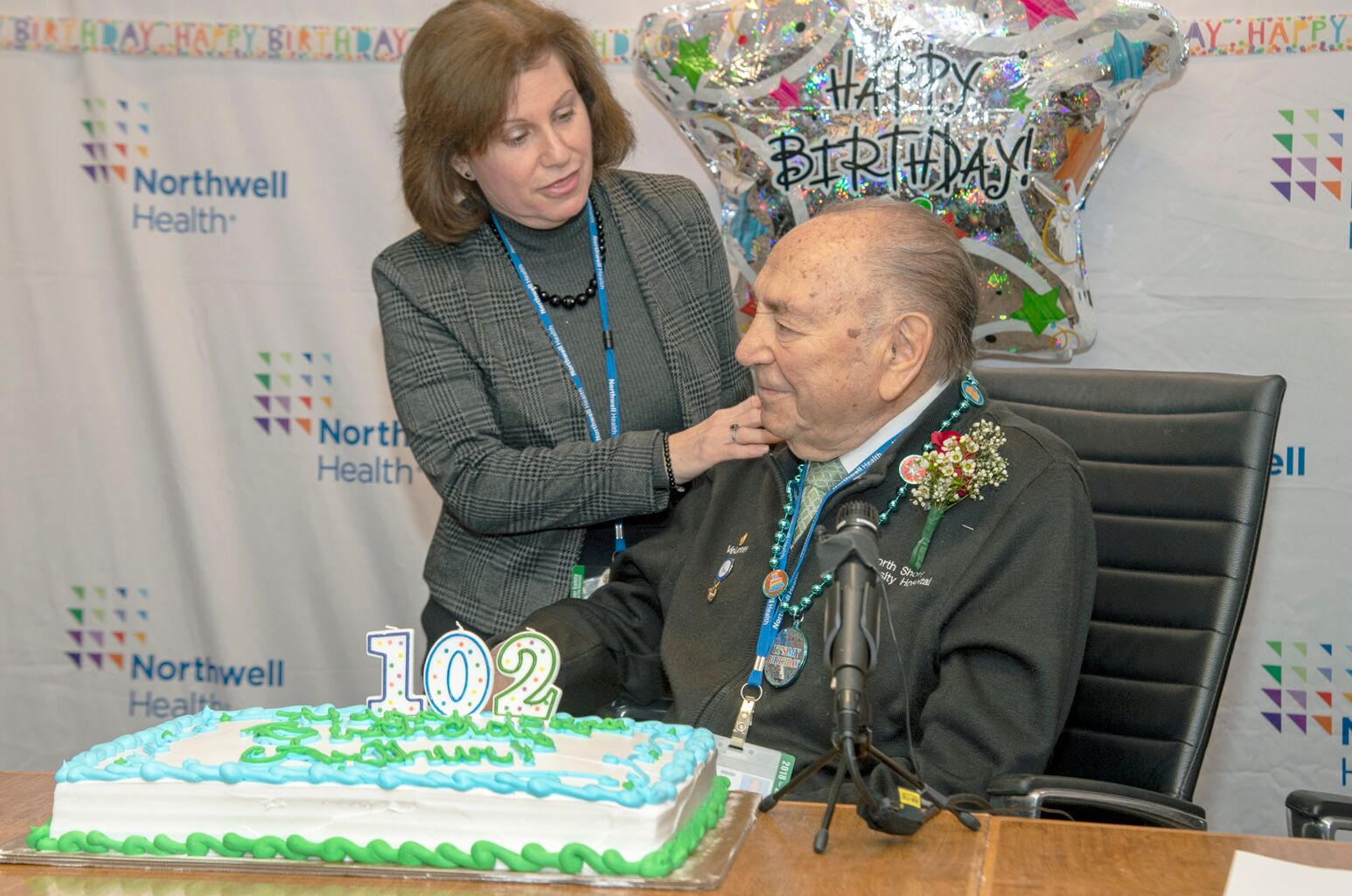 North Shore University Hospital Director of Volunteer Services Lisa Breiman with Arthur Seidman at his surprise birthday party.