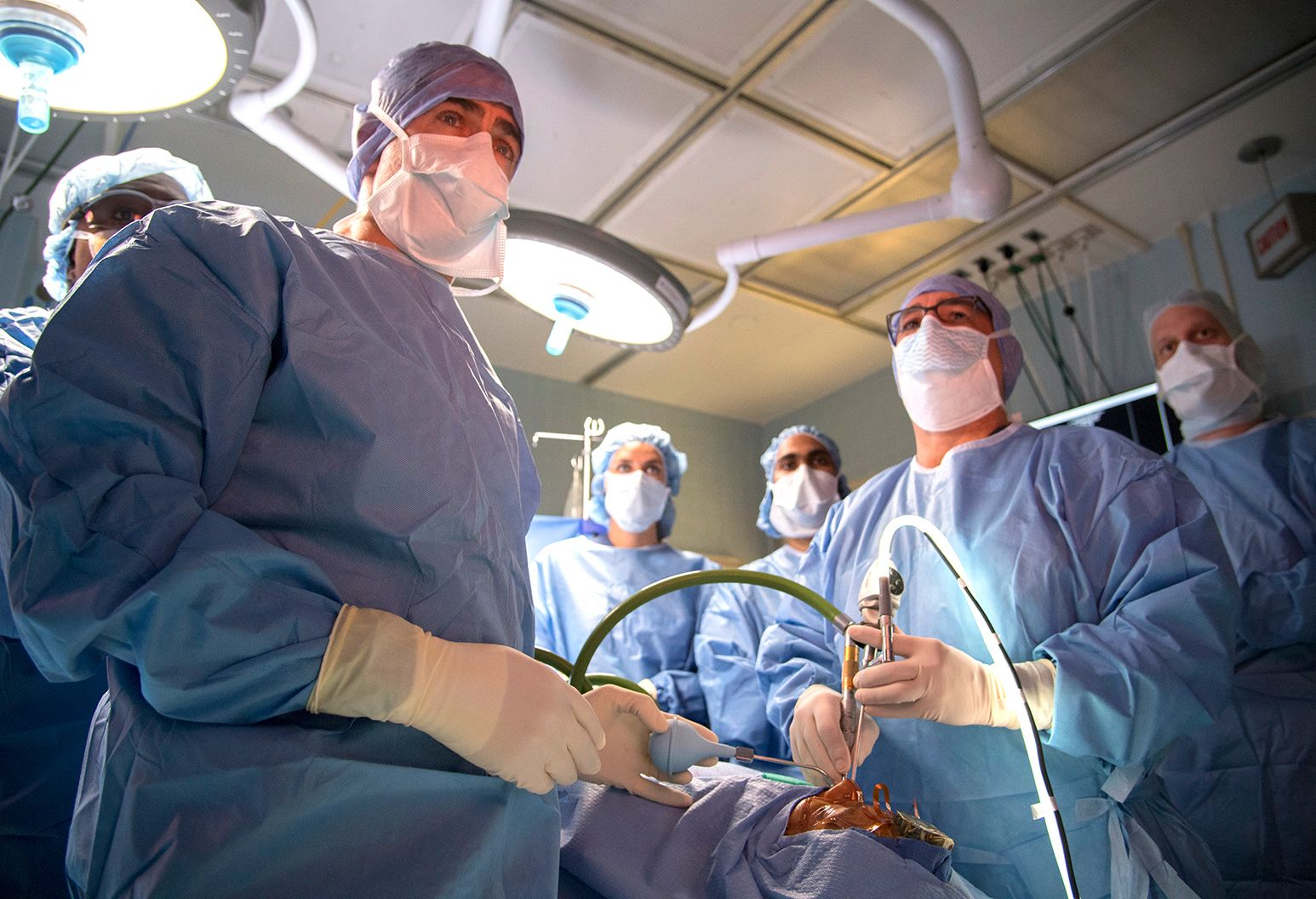 Room of surgeons performing surgery in an operating room