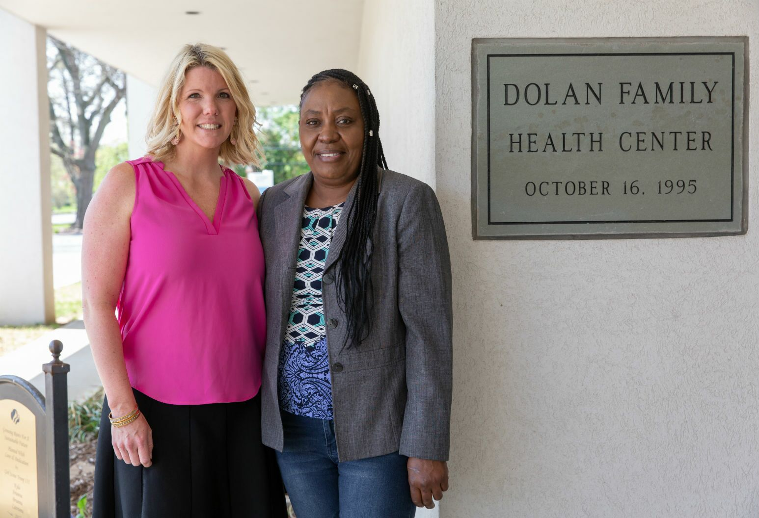Lauryn Koke, Pink Aid grant committee co-chairperson, with patient Pamella.