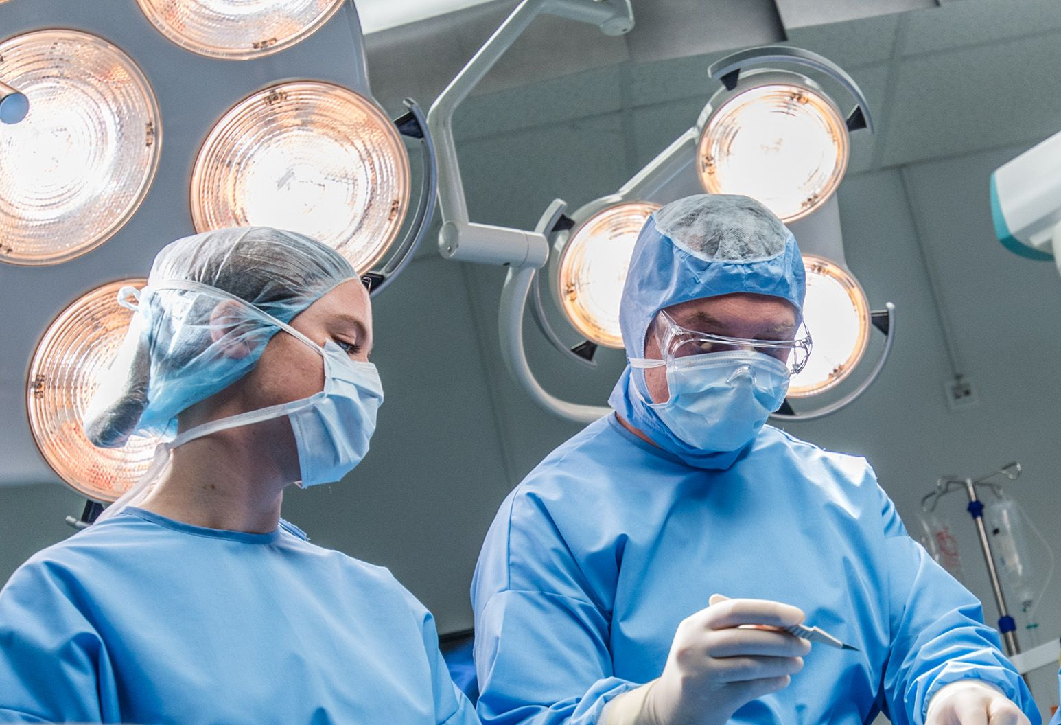 Two surgeons in the operating room preparing for surgery
